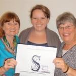 SR 2013 Bursary Winner Tori Wines receiving her cheque from Maria Duncalf-Barber and Sandy Yudin